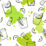 Colored seamless vector pattern of tequila shots with splashes o Stock Photography
