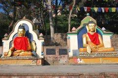 Colored seated Buddha statues -Swayambhunath-Nepal. Colored seated Buddha statues - surrounding the Swayambhunath stupa also called the `Monkey Temple royalty free stock photography