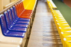 Colored seats at a stadium in the room Royalty Free Stock Photos