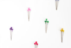 Colored sewing pins. Many colored sewing pins on white background Royalty Free Stock Photography