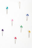 Colored sewing pins. Many colored sewing pins on white background Stock Images