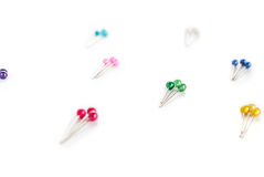 Colored sewing pins. Many colored sewing pins on white background Royalty Free Stock Photo