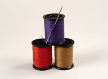 Colored Sewing Spools. Photo of 3 Spools and Needle stock image