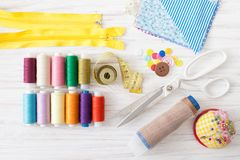 Colored sewing thread, supplies for sewing machine on white royalty free stock photography