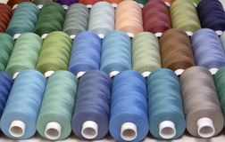 Colored sewing threads in spools,different colors Royalty Free Stock Photography