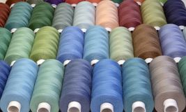 Colored sewing threads in spools,different colors Royalty Free Stock Photo