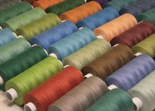 Colored sewing threads in spools,different colors Stock Photo