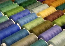 Colored sewing threads in spools,different colors Stock Image