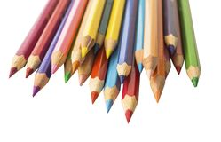Colored sharpened pencils on a white background stock image