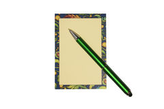 Colored sheet for notes and a green pen on a white background. Can. It can be used to add custom text Stock Image