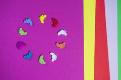 Colored sheets of paper, handmade, footprints in a circle Stock Photography