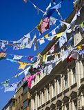 Colored shirts on a clothesline with building Royalty Free Stock Image