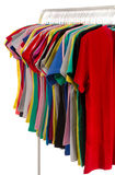Colored shirts on hangers in a row. Royalty Free Stock Photo