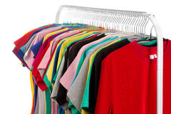Colored shirts on hangers steel. Royalty Free Stock Photos