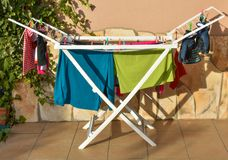 colored shirts, socks, pijamas, t-shirts, underpants, gloves and other clothes wet after being washed, hold in a washing line at royalty free stock image