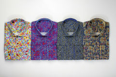 Colored shirts on white Royalty Free Stock Photography