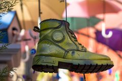 Colored shoe hanging on a cord. Bright and colorful composition. boot - abstraction on a blurred background stock image