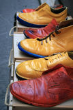 Colored shoes. A shot of colored used shoes Stock Photos