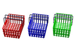 Colored shopping baskets isolated on white background Stock Photography