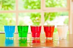 Colored shots glass Royalty Free Stock Image