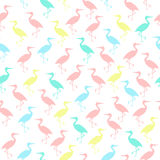 Colored silhouettes of storks seamless pattern. Irregular. Pink, blue green and yellow colors Stock Photo