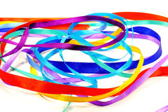 Colored ribbons. Colored silk, playfully,twisted tape in on a white background Royalty Free Stock Images