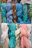 The colored silk scarfs in rows in market Stock Image