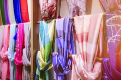 Colored silk scarfs in rows in shop.  Stock Photography