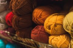 Colored skeins of wool on a store shelf. Woolen skeins for knitting all the colors of the rainbow, blue, brown, red and purple