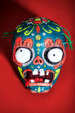 Colored skeleton mask on a red background Royalty Free Stock Photo