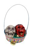 Colored skulls in an Easter basket Royalty Free Stock Images