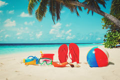 Colored slippers, toys and diving mask at beach Royalty Free Stock Image