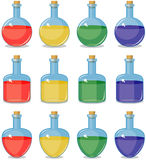 Colored small bottles Royalty Free Stock Images