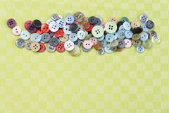 Colored small buttons on a green background stock photos