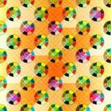 Colored small circles on an orange background Seamless geometric abstract pattern Royalty Free Stock Images