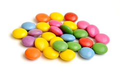 Colored smarties on white background. Pile of colored smarties on white background Stock Images