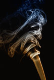 Colored smoke on black Stock Images
