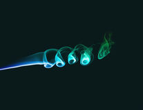 Colored smoke on dark green background Royalty Free Stock Images