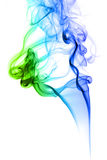 Colored smoke on green and blue. Colored smoke in white background Royalty Free Stock Photography