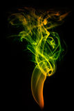 Colored smoke isolated on black Royalty Free Stock Photos