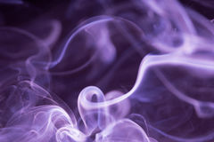 Colored smoke isolated on a black background. Purple colored smoke isolated on a black background stock photos