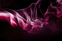 Colored smoke isolated on a black background Stock Images