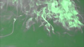 Colored smoke swirls through the air stock footage