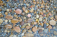 Colored smooth stones polished by Baikal Lake skillfully Royalty Free Stock Photo