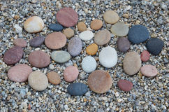 Colored smooth stones polished by Baikal Lake skillfully Royalty Free Stock Images