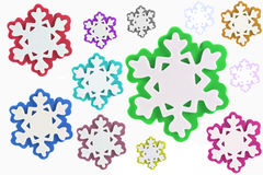 Colored snowflakes isolated. Colorful snowflakes isolated in a white background stock photography