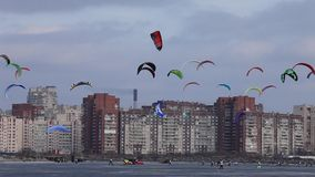 Colored snowkiting in the sky over a city Royalty Free Stock Photos