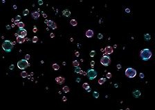 Bubbles on black background stock images