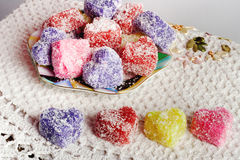 Colored soap. In the form of heart on a white tablecloth Royalty Free Stock Photos