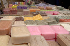 Colored soaps. Soaps colored skin at market stall Stock Photo